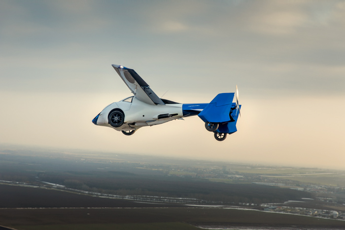 Flying car during the testing flight. It is driven by Štefan Klein, AEROMOBIL Co-FOUNDER, CTO, CHIEF DESIGNER. AeroMobil transforms in seconds from an automobile to an airplane. Aeroport Nitra, Slovakia, 2015