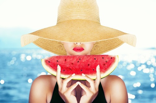 Fashion portrait with a sexy girl with watermelon