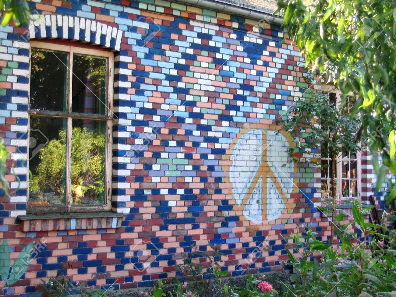 2602567-Graffiti-on-bricks-wall-in-Freetown-Christiania-Copenhagen-Denmark-Stock-Photo